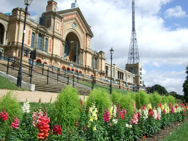 Exterior shot of Alexandra Palace with flowers in the foreground