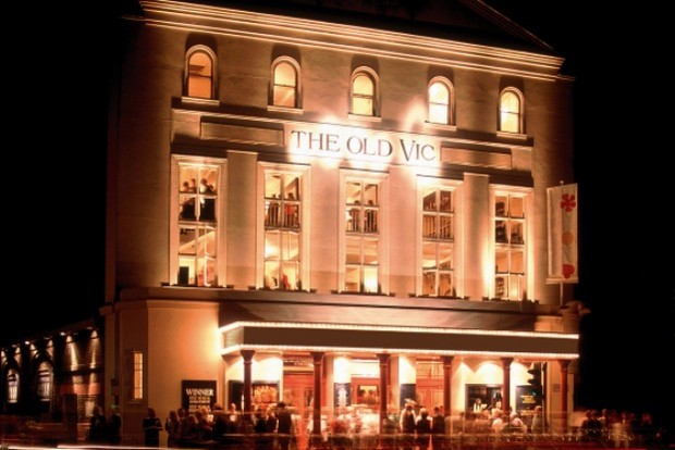Outside of the Old Vic at night with lights on and sign lit up