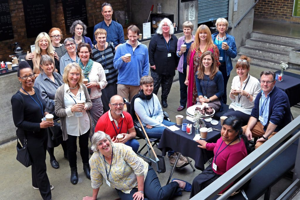 Group photo of VocalEyes team taken in foyer of the Almeida Theatre.