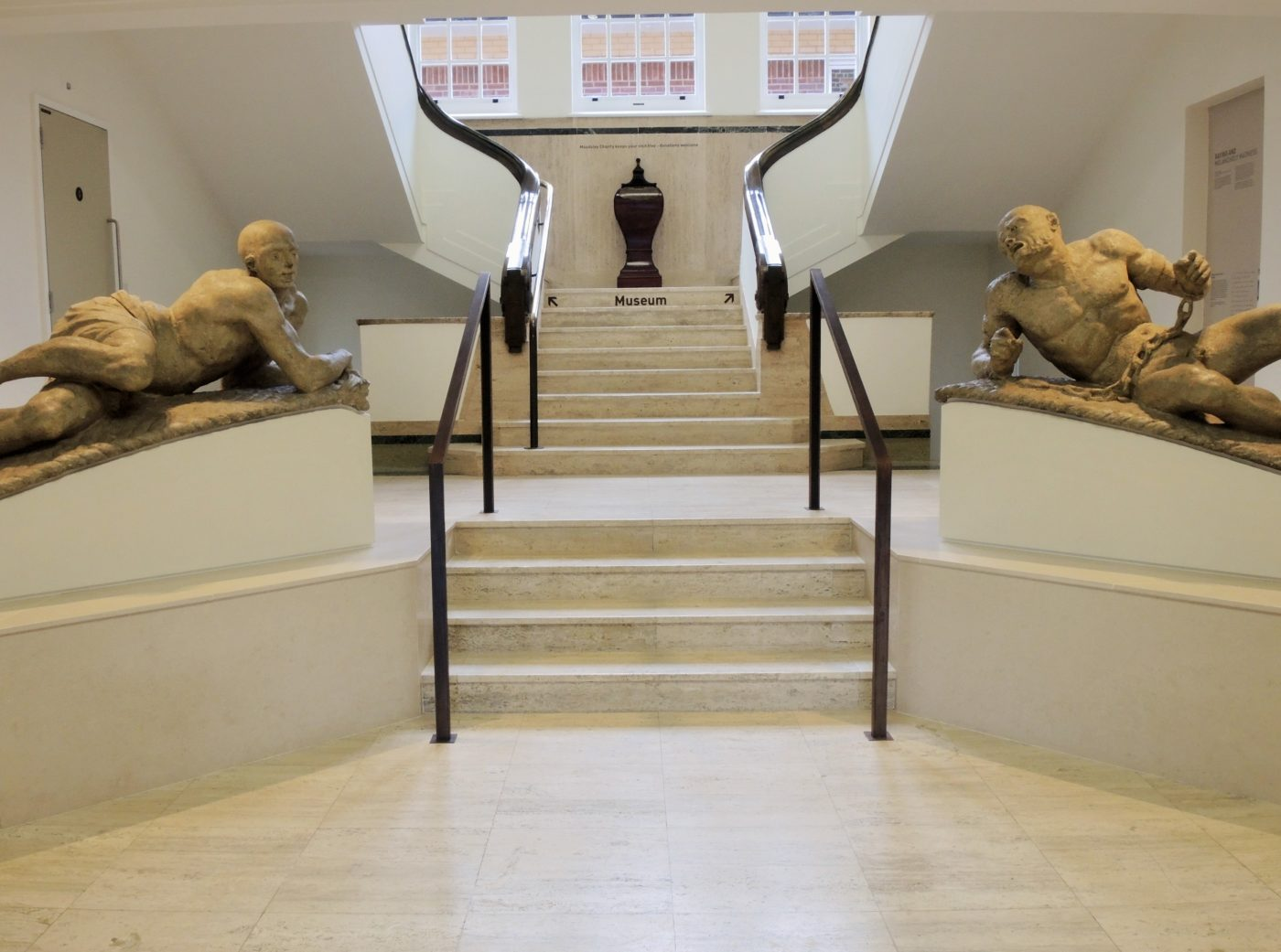 Sculptures Raving and Melancholy at the entrance to Bethlem Museum of the Mind
