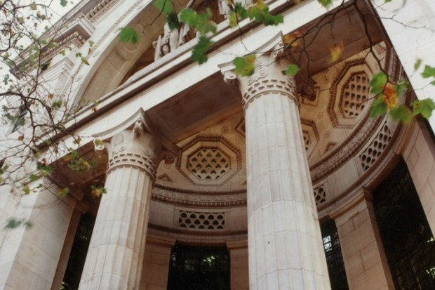 Looking up at the entrance of Bush House with pillars and a dome