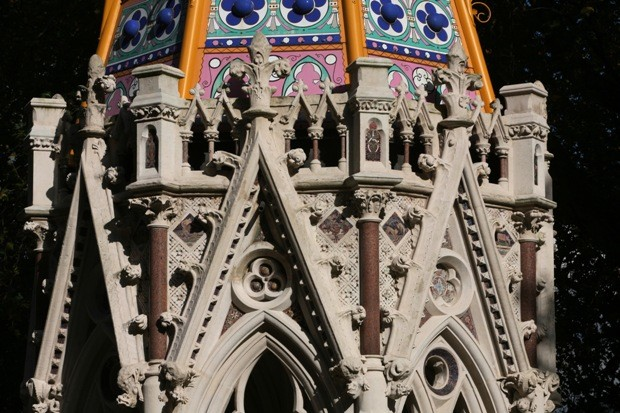 Close up of top of Buxton Memorial with intricate carvings and coloured panels