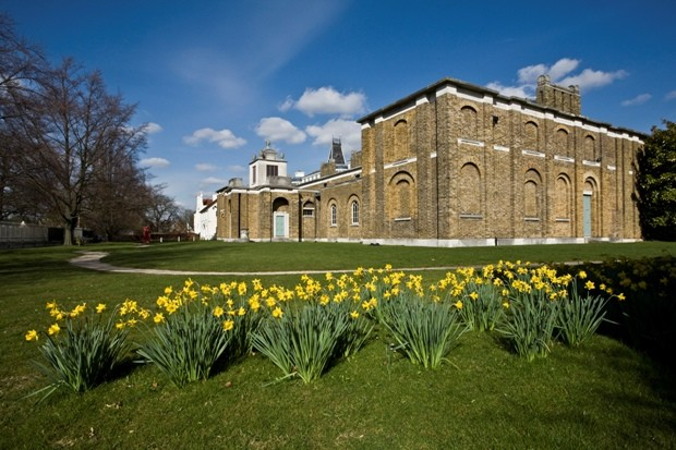 Photograph of the corner view of Dulwich Picture Gallery with grass and daffodils in front