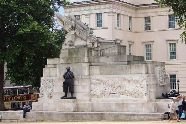 Close up of memorial. A large gun in stone and soldiers in black