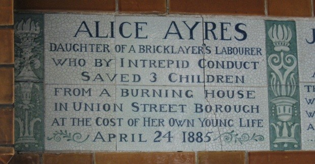 Close up of sign on memorial which commemorates Alice Ayres