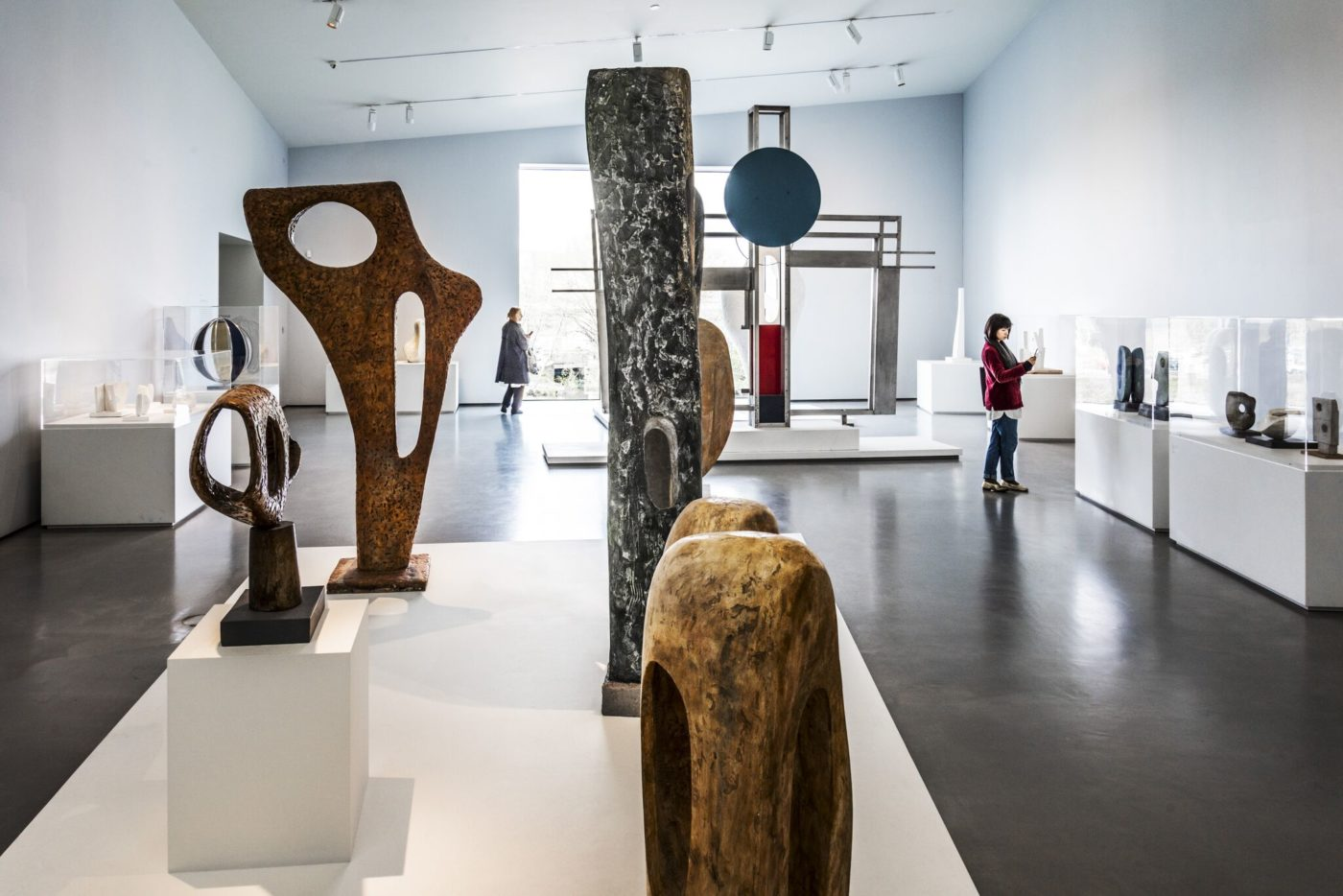 View of gallery interior, showing modern sculpture