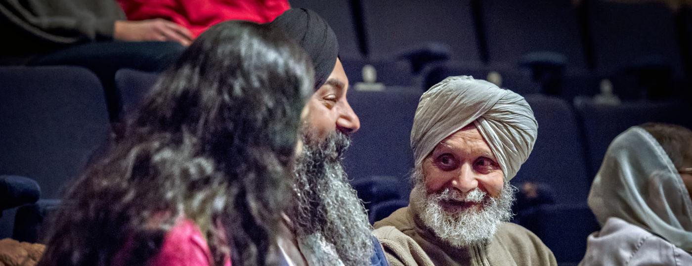 Three men in theatre auditorium