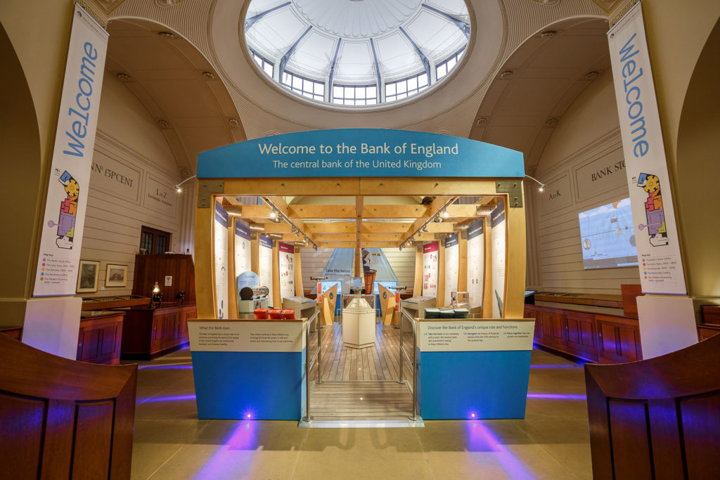 Interior of the museum with a large blue and white boat in the centre of the gallery