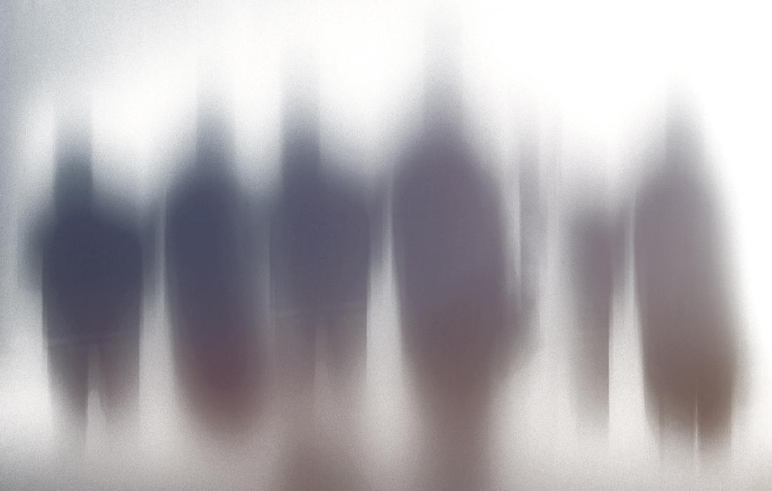 Blurred figures on a white background