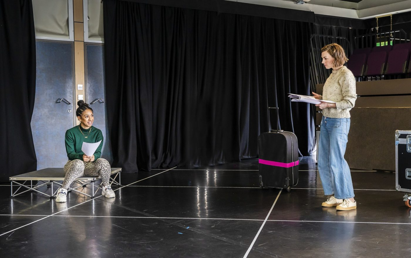 Two female actors in rehearsal room