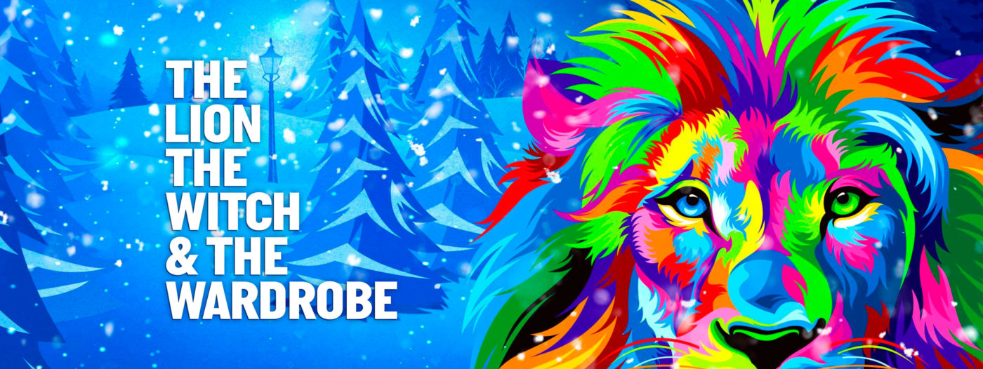 """Snow falling and covering the curving ground and angular """"cut-out"""" trees in a pine forest with a single old fashioned street light in a clearing. The falling snow is white blobs, the rest is represented by various shades of blue. Filling almost the whole right half of the image is a multicoloured Lion's face and mane – with bright green, red, pink, orange, blue, yellow and purple. It looks straight out at us. Left of centre in thick block capitals, the title: The Lion, The Witch & The Wardrobe."""
