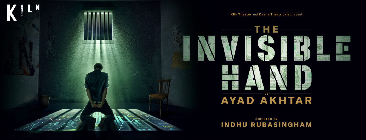 """A prison cell. A man on his knees facing away from us with his arms handcuffed behind his back. Light comes through the barred window above him casting images of a graph on the floor around him. Text: Kiln Theatre and Dasha Theatricals Present The Invisible Hand by Ayad Akhtar, Directed by Indu Rubasingham. The words """"Invisible Hand"""" are created in block capitals by strips cut from 100 dollar bills."""