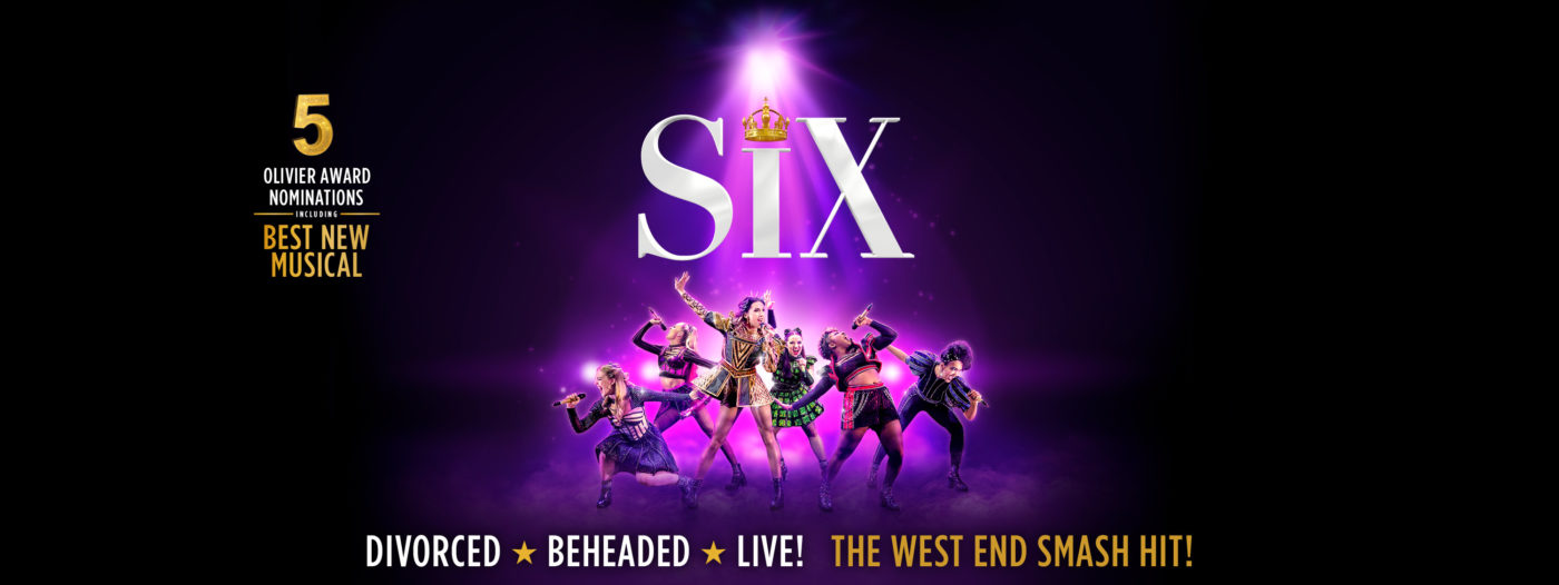 """The image is mainly black. Purple light project down from the top centre and forward from the image centre on to six women all in various poses singing into microphones and wearing black heeled boots and Tudor period costumes that have been glitzified. Above them the word """"Six"""" with a crown as the dot above the I. To the left the text reads: """"5 Olivier Award Nominations including Best New Musical"""" and along the bottom the text reads: """"Divorced * Beheaded * Live! The West End Smash Hit!"""""""