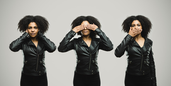 A young black woman viewed 3 times, firstly with her hands over her ears, then over her mouth and then over her eyes