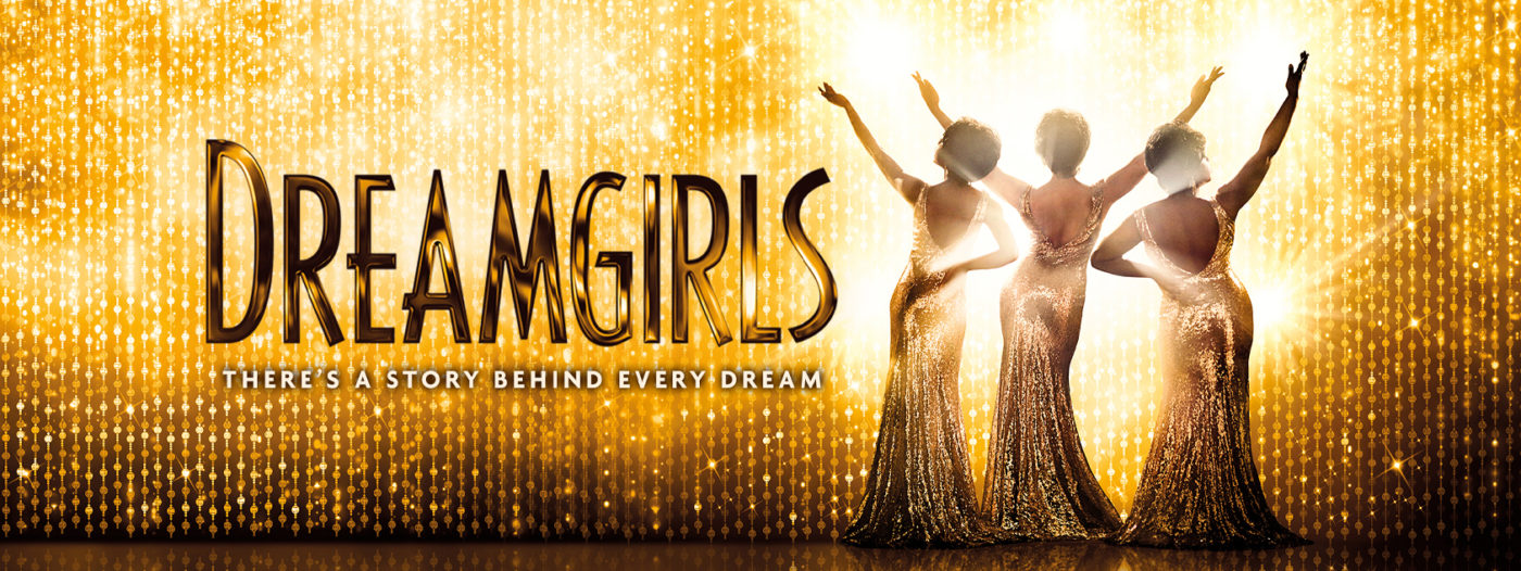 A gold sequin curtain drapes the whole of the stage, three Dreamgirls in long silver sequin dresses with their arms pointing in the air facing outwards towards the audience. Text reads: Dreamgirls there's a story behind every dream.
