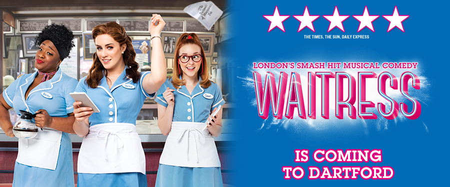 Three waitresses in diner uniforms stand together. One holds a coffee pot and gives a knowing look, another is poised to take down an order on her pad. In the centre, the third waitress has ripped a page from her note pad and flings it into the air. On the right are the words, London's smash hit musical WAITRESS is coming to Dartford.