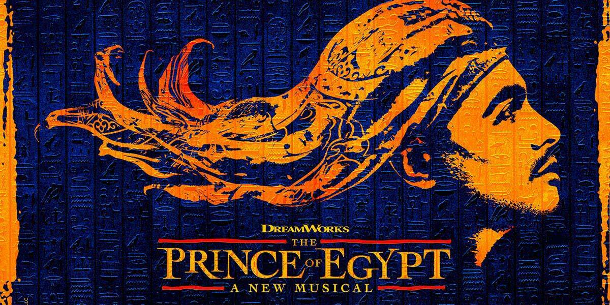 Over a background of Egyptian hieroglyphics, is a man's face in profile, a scarf on his head flows out behind him, caught by the wind. Below are the works Dreamworks, The Prince of Egypt, a new musical.