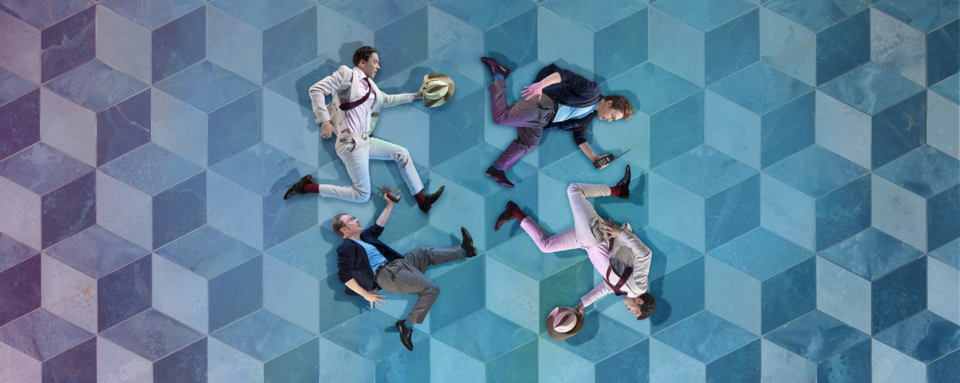 On a blue Escher-style tiled background, the cutout images of four men form a circle. Each man is holding a mobile phone or a trilby hat; they are pursuing each other or running away, in a mad, circular chase.