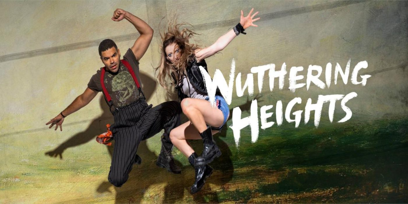 A man and a woman leap into the air energetically. He is wearing pinstriped trousers with bracers over a t-shirt; she has shorts, a sleeveless leather jacket and black boots. Behind them is a painted wall with an impression of a landscape. The words Wuthering Heights is written, like graffiti, over the picture.