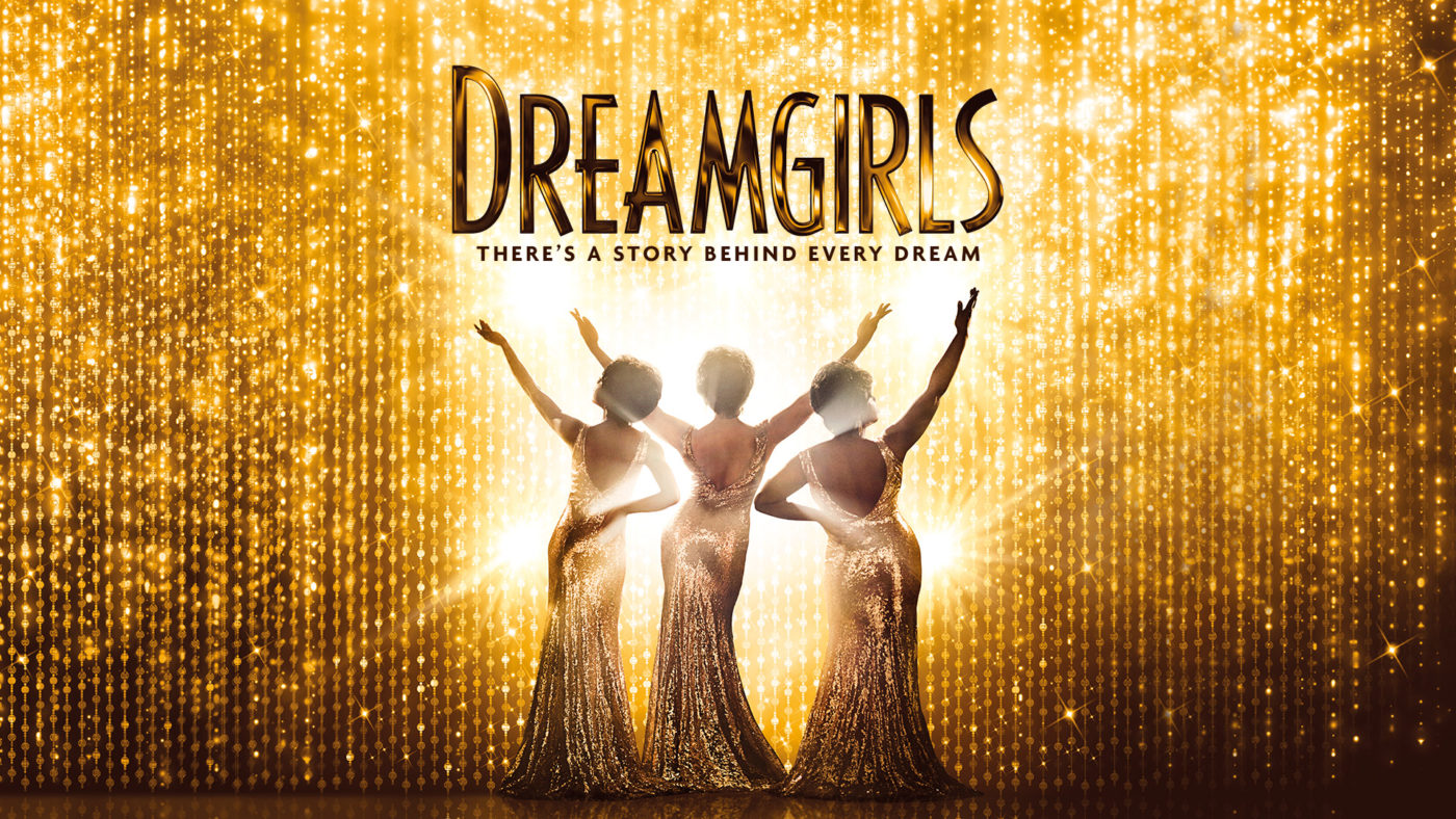 A gold sequin curtain drapes the whole of the stage, three Dreamgirls in long silver sequin dresses with their arms pointing in the air facing outwards towards the audience. Text reads: Dreamgirls there's a story behind every dream