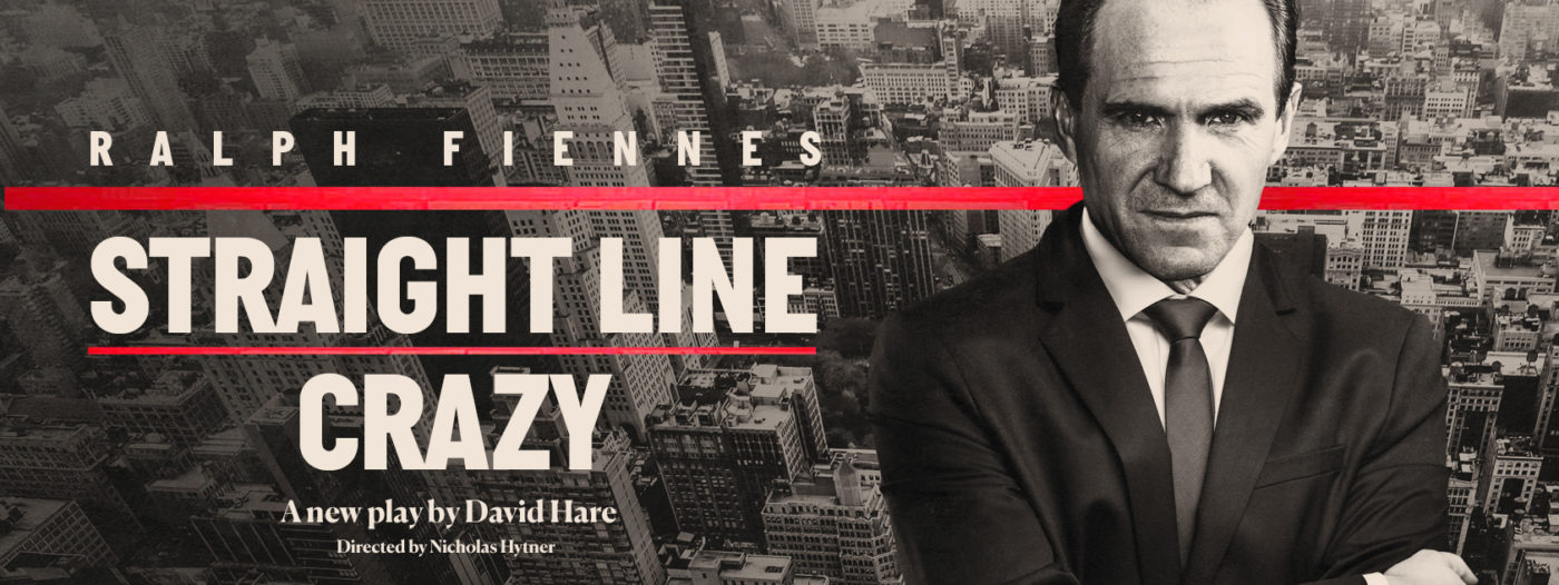 Ralph Fiennes (dark hair, black suit and tie), arms folded, frowning. The background shows New York from above with a red line horizontally across the middle. In white letters, 'Straight Line Crazy', underneath 'A new play by David Hare', 'Directed by Nicholas Hytner'.